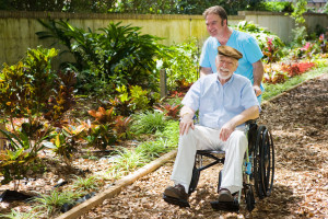 Senior Enjoying Garden with Aide