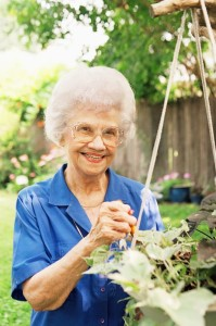 Elderly woman in Delray Beach garden